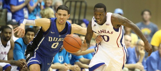 Kansas guard Tyshawn Taylor is fouled fighting for a loose ball with Duke guard Austin Rivers during the first half Wednesday, Nov. 23, 2011 at the Lahaina Civic Center.