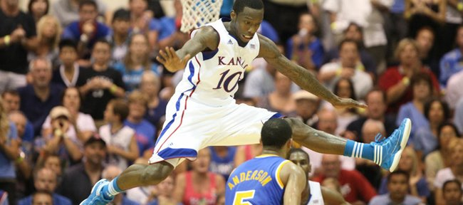 Kansas guard Tyshawn Taylor gets airborne as he defends against a pass from UCLA guard Jerime Anderson during the second half Tuesday, Nov. 22, 2011 at the Lahaina Civic Center.