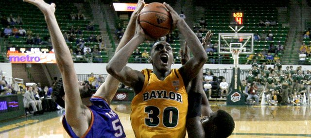 Texas-Arlington forward Jordan Reves, left, and Bo Ingram (1) defend against a shot attempt by Baylor forward Quincy Miller (30) in the second half Wednesday, Nov. 23, 2011, in Waco, Texas. Baylor won 75-65.