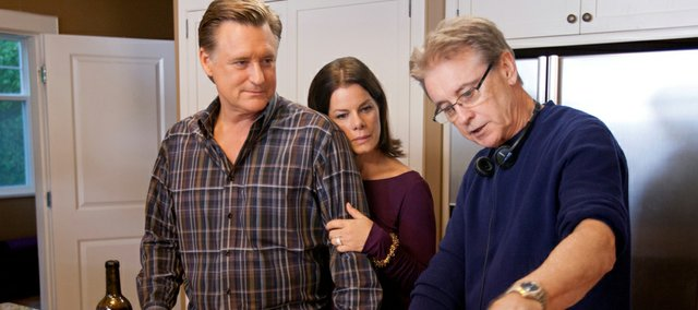Here, Robe directs Marcia Gay Harden and Bill Pullman in between takes. Robe said that working with a cast that includes Richard Schiff and Alfred Molina in addition to Pullman and Harden wasn't intimidating because of how well the cast worked with each other and with him.