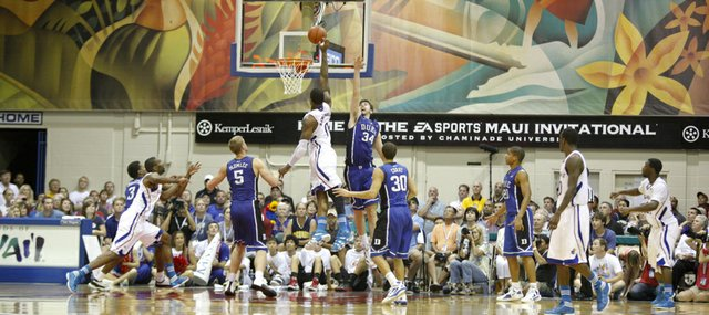 Kansas forward Thomas Robinson puts a shot over Duke forward Ryan Kelly during the second half on Wednesday, Nov. 23, 2011 at the Lahaina Civic Center.