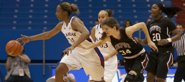 Kansas forward Carolyn Davis (21) leads a fast break after stealing the ball from IUPUI's Nevena Markovic (34) on Saturday, Nov. 26, 2011 at Allen Fieldhouse.