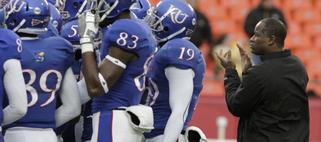Kansas head football coach Turner Gill prepares his team before the Border War against Missouri on  Saturday, Nov. 26, 2011 at Arrowhead Stadium.