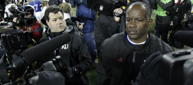 Kansas head coach Turner Gill leaves the field after KU's loss to Missouri in the Border War on Saturday, Nov. 26, 2011 at Arrowhead Stadium.