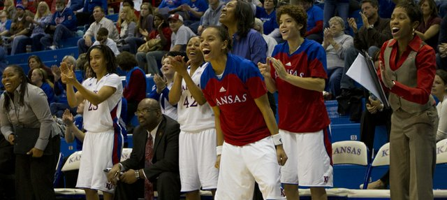 Angel Goodrich and the rest of the Kansas bench cheer late in the game during Kansas' game against Lamar in the Basketball Travelers Classic Friday, Nov. 25, 2011 at Allen Fieldhouse.