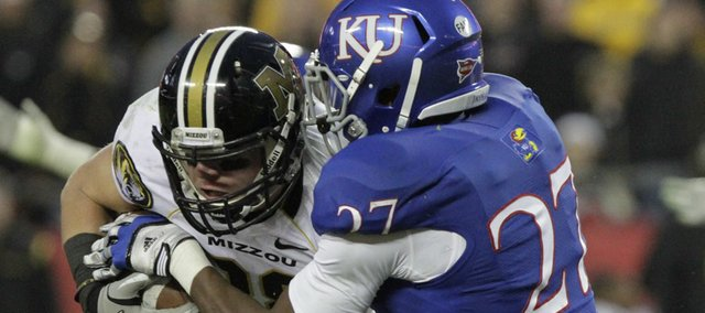 Kansas safety Victor Simmons (27) wraps up Missouri wide receiver T.J. Moe during second half Saturday, Nov. 26, 2011 at Arrowhead Stadium.