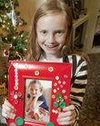 Catharine Richards, 9, shows off the hand-decorated picture frame she made for their grandparents.