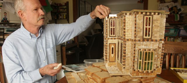 Clark Fulton has transformed gingerbread into a 1800s-style home for this year's Gingerbread House Festival and Auction.