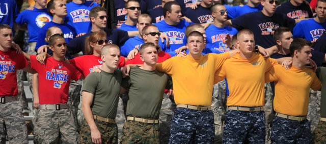 Kansas ROTC members sing the Alma Mater prior to kickoff against Georgia Tech, Saturday, Sept. 11, 2010 at Kivisto Field. A Kansas University student and Marine Corps veteran believes recent changes to the GI Bill are unfair to veterans who attend public universities as out-of-state residents.