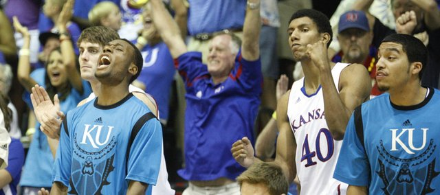 The Kansas bench celebrates a late bucket against UCLA during the second half Tuesday, Nov. 22, 2011 at the Lahaina Civic Center.