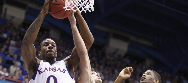 Kansas forward Thomas Robinson pulls a rebound away from Florida Atlantic's Pablo Bertone (25) and Jordan McCoy (21) during the second half on Wednesday, Nov. 30, 2011 at Allen Fieldhouse.