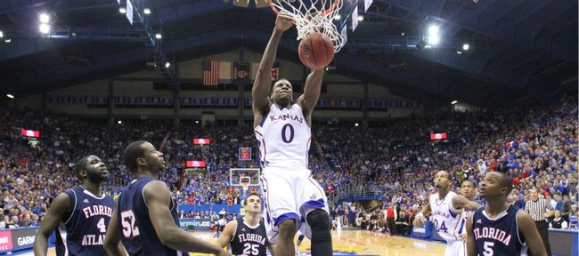 Kansas forward Thomas Robinson dunks on the Florida Atlantic defense during the second half Wednesday, Nov. 30, 2011 at Allen Fieldhouse.