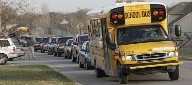 Students leave Lawrence Free State High School Thursday morning after the administration and Lawrence Police evacuated the building because of a bomb threat. It was reported by some students that a note that mentioned a bomb had been found on a door to the school Thursday morning.