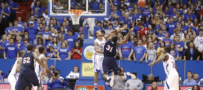 Kansas guard Travis Releford rejects a shot by Florida Atlantic guard Omari Grier during the second half on Wednesday, Nov. 30, 2011 at Allen Fieldhouse.