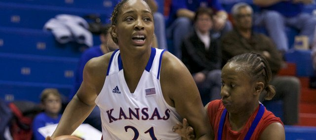 Kansas forward Carolyn Davis (21) works around SMU's Krystal Johnson during second half action on Thursday, Dec. 1, 2011, at Allen Fieldhouse.  Kansas beat SMU, 75-52.