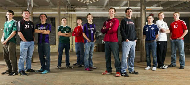 The 2011 Lawrence Journal-World All-Area boys soccer team: from left, Jake Walter, Free State; Justin Riley, Lawrence High; Louis Joslyn, Baldwin; Zack Thompson, Free State; Marcus Titterington, Tonganoxie; Clint Chapman, Baldwin; Tanner Click, Lawrence High; coach Mike Murphy, Lawrence High; Jack Lopez, Mill Valley; John Williams, De Soto; and Matt Saathoff, Tonganoxie.