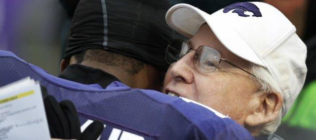 Kansas State coach Bill Snyder, right, hugs senior quarterback Sammuel Lamur before taking on Iowa State Saturday, Dec. 3, 2011, in Manhattan, Kan.