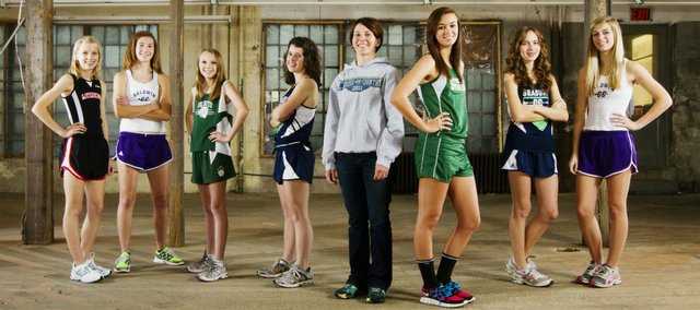The 2011 Lawrence Journal-World All-Area girls cross country team, from left: Grace Morgan, Lawrence High; Katie Jones, Baldwin; Rebekah Burgweger, De Soto; Maddie McCaffrey, Seabury; coach Christi Douglas, Seabury; Lynn Robinson, Free State; Kate Albrecht, Seabury; Carol Whaley, Baldwin.