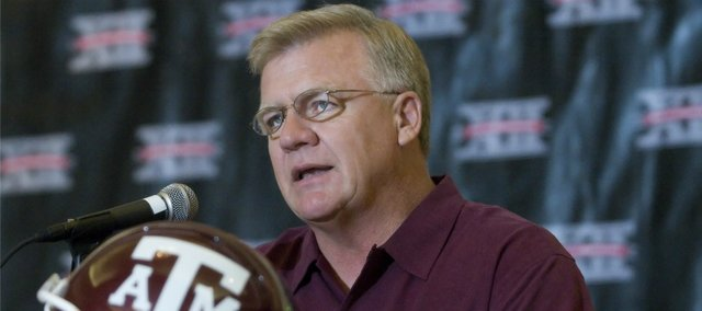 Texas A&M head football coach Mike Sherman addresses media members during Big 12 Media Days at the Kansas City Marriott Downtown in this 2008 file photo.
