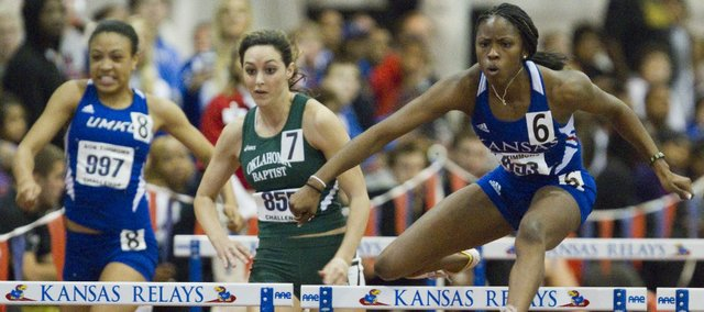 Kansas runner Rebecca Neville, right, finished first on the Women's 60-meter hurdles during the Bob Timmons Challenge on Friday, Dec. 2, 2011 at Anschutz Pavilion.