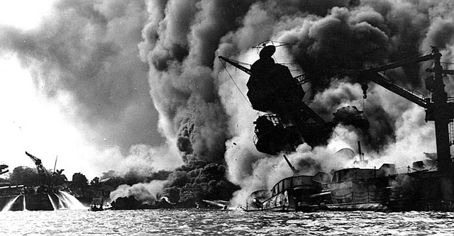 The U.S.S. Arizona burns after being attacked the Japanese at Pearl Harbor, Dec. 7, 1941.