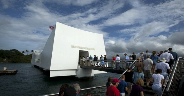 Pearl Harbor visitors enter the U.S.S. Arizona Memorial, which is built over the sunken remains of the battleship, to experience and pay their respects, Saturday, Nov. 19, 2011. Of the 2,400 Americans who died in the Dec. 7, 1941 attack on Pearl Harbor, 1,177 were killed on board the Arizona. This year marks the 70th anniversary of the attack, which escalated the United State&#39;s involvement into World War II.