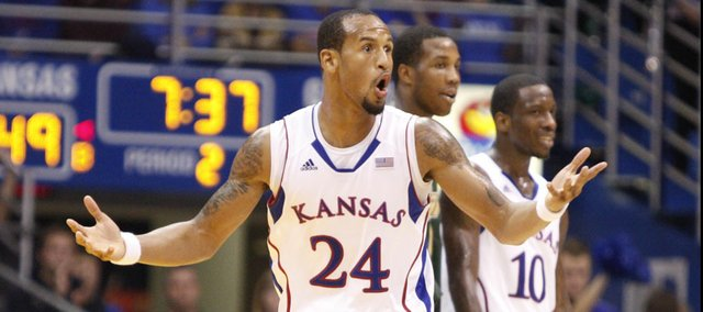 Kansas guard Travis Releford disputes a call with an official during the second half on Saturday, Dec. 3, 2011 at Allen Fieldhouse.