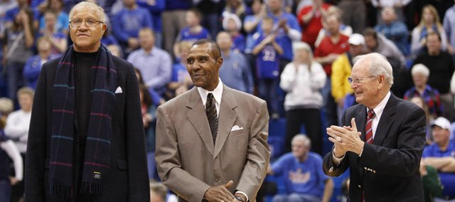 Former Kansas players on the 1966 team Walt Wesley, left, and JoJo White stand with then head coach Ted Owens as they are honored at halftime of the South Florida game on Saturday, Dec. 3, 2011 at Allen Fieldhouse.
