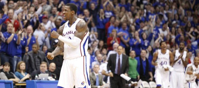 Kansas forward Thomas Robinson pumps his fist after a bucket by teammate Elijah Johnson against Long Beach State during the first half Tuesday, Dec. 6, 2011 at Allen Fieldhouse.