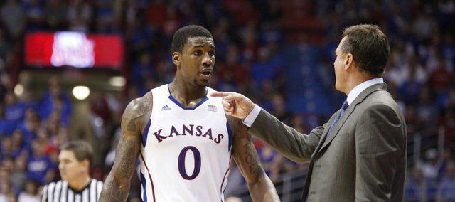 Kansas head coach Bill Self has words for forward Thomas Robinson after Robinson picked up two quick fouls during the second half on Saturday, Dec. 3, 2011 at Allen Fieldhouse.