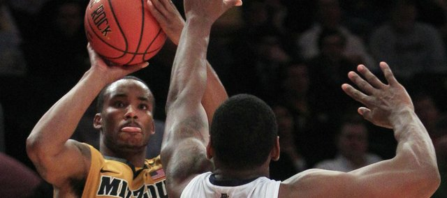 Missouri's Marcus Denmon (12) shoots over Villanova's James Bell (32) during the second half in the Jimmy V Classic on Tuesday, Dec. 6, 2011, in New York. Missouri won 81-71.