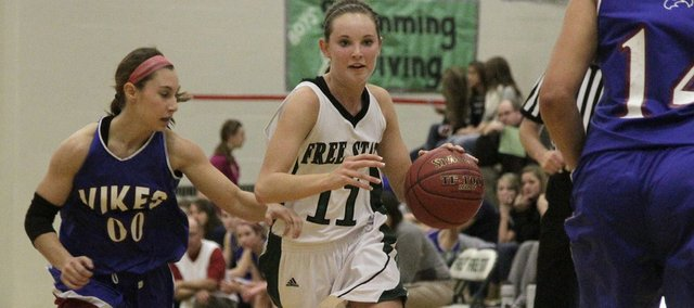 Free State's Kennedy Kirkpatrick (11) drives to the paint against Topeka Seaman on Tuesday, Dec. 6, 2011 at FSHS. Free State defeated Seaman, 39-30.