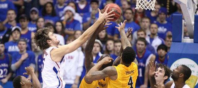 Kansas center Jeff Withey fights for a rebound against Long Beach State during the first half Tuesday, Dec. 6, 2011 at Allen Fieldhouse.