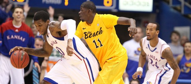 Kansas forward Thomas Robinson comes away with a steal as he is pressured by Long Beach State forward James Ennis during the first half Tuesday, Dec. 6, 2011 at Allen Fieldhouse.
