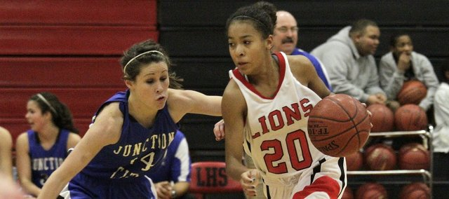 Freshman Marissa Pope (20) drives against Junction City on Tuesday, Dec. 6, 2011 at LHS. The Lady Lions defeated the Blue Jays, 35-30.