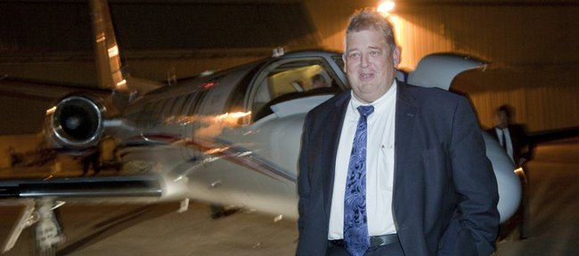 Charlie Weis, formerly the offensive coordinator at Florida, gets off the Kansas University plane at the Lawrence Airport on Thursday night around 8:30 p.m. Weis has agreed to become the 37th football coach in KU history. KU will hold a press conference to introduce Weis on Friday.
