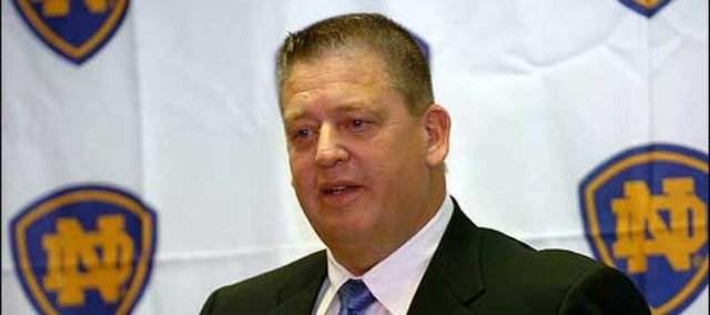 New Notre Dame football coach Charlie Weis talks at his inaugural