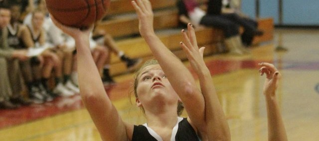 Free State's Chelsea Casady (32) scores against Shawnee Heights on Friday, Dec. 9, 2011 in Topeka.