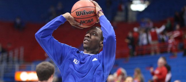 Kansas guard Tyshawn Taylor pulls up for a jumper during warmups prior to tipoff against Ohio State on Saturday, Dec. 10, 2011 at Allen Fieldhouse.