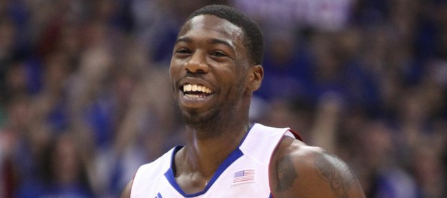Kansas guard Elijah Johnson smiles after hitting a three-pointer against Ohio State during the first half on Saturday, Dec. 10, 2011 at Allen Fieldhouse.