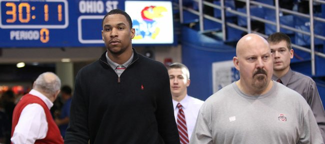 Ohio State forward Jared Sullinger makes his way to the court in street clothes prior to tipoff against Kansas on Saturday, Dec. 10, 2011 at Allen Fieldhouse.