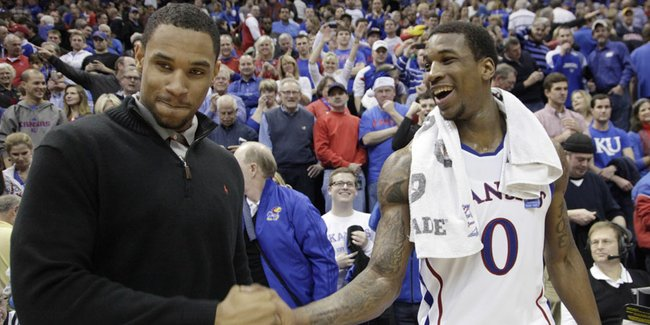 Ohio State's Jared Sullinger, left, who did not suit up because of an injury, greets Thomas Robinson after the Jayhawks 78-67 win over #2 nationally ranked Ohio State University at Allen Fieldhouse, Dec. 10, 2011. ..