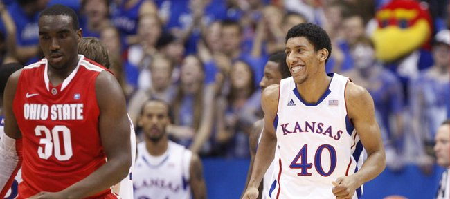 Kansas forward Kevin Young flashes a smile after taking a charge against an Ohio State player during the first half Saturday, Dec. 10, 2011 at Allen Fieldhouse.