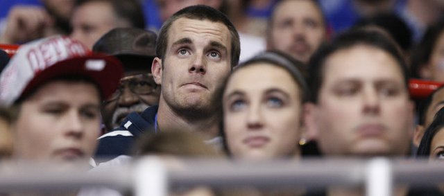 Kansas football recruit Dayne Crist watches from the stands during the second half on Saturday, Dec. 10, 2011 at Allen Fieldhouse.