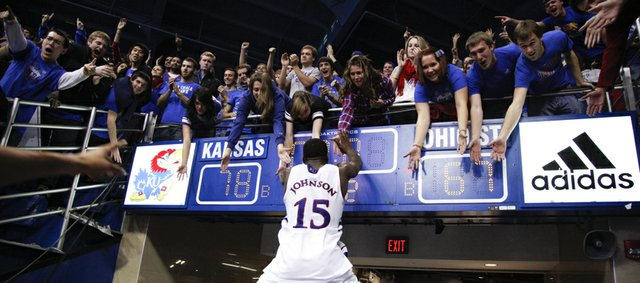 Kansas guard Elijah Johnson gets up to slap hands with the students after the Jayhawks' 78-67 win over Ohio State on Saturday, Dec. 10, 2011 at Allen Fieldhouse.