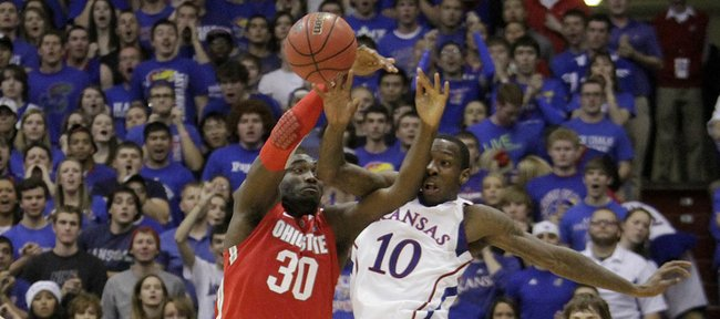 Evan Ravenel (30) and Tyshawn Taylor (10) collide going after a loose ball during the second-half of the Jayhawks 78-67 win over #2 nationally ranked Ohio State University at Allen Fieldhouse, Dec. 10, 2011. ..