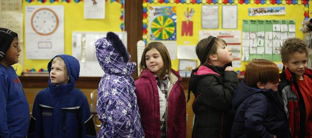 Students in Nancy Orsburn's second-grade class at New York School line up to head outside for recess on Monday, Dec. 12, 2011. On Monday, proposals were submitted by representatives of New York and Cordley schools on the topic of consolidation. Both groups believe their is room to expand on the campuses of their respective schools.