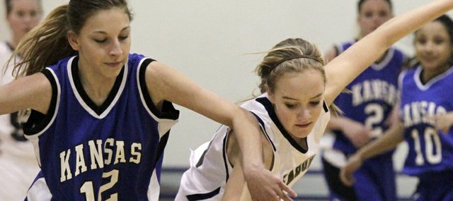 Bishop Seabury sophomore Heidi Dumesich, right, steals the ball away from Kansas School of the Deaf's Kylie Garcia (12) in the second half on Monday, Dec. 12, 2011, during girls basketball action at Bishop Seabury.  Seabury defeated KSD, 46-16.