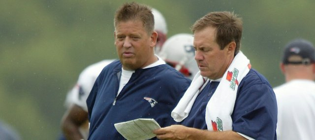 New England Patriots' head coach Bill Belichick, right, goes over plays with former offensive coordinator (and current Kansas University football coach) Charlie Weis, left, during training camp in this file photo from Aug. 1, 2004, in Foxboro, Mass.