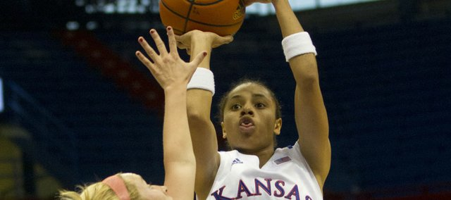Kansas' Angel Goodrich (3) hits a pull-up jumper over defender Drew Roberts during Kansas' final exhibition game against Pittsburg State Sunday, Nov. 6, 2011 at Allen Fieldhouse. The Jayhawks, who won 68-43, open the season at home against Western Michigan on Nov. 13.